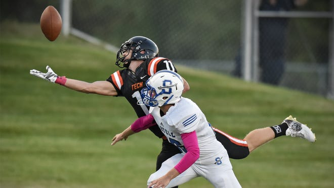 St. Cloud Tech's James Kaczor reaches to attempt a reception against Sartell's Jacob Shea last Sept. 9 at Husky Stadium. Kaczor, who will be a senior this fall, has verbally committed to play football at North Dakota State.