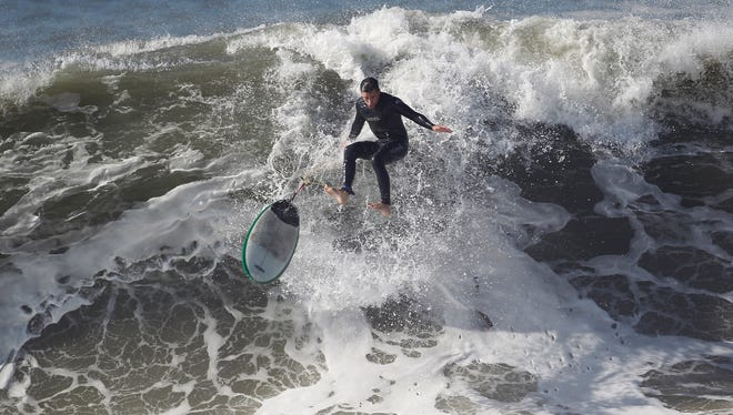 A surfer wipes out from a large wave at Seal Beach on Wednesday, Aug. 27,  2014.