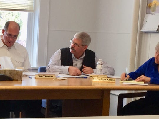 Perry Johnson, center, executive director of POST council, makes a recommendation at Tuesday's meeting.