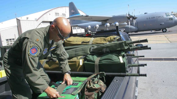 Maj. Ben Meadows loads up some equipment prior to a 2010 training mission.