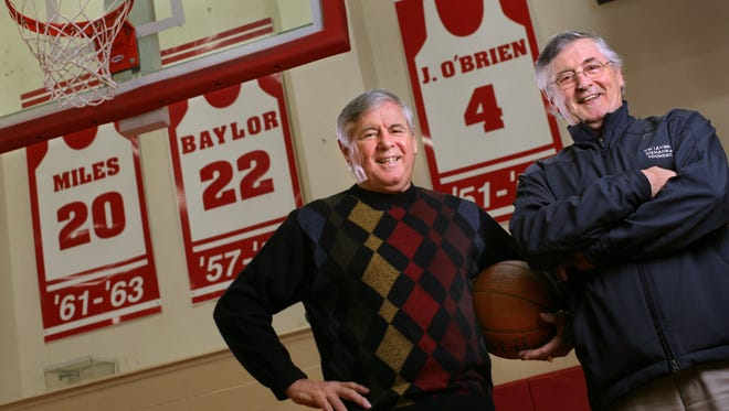 Twins and former Seattle University basketball players Eddie, left, and Johnny O'Brien in front of Johnny's retired jersey in  2006 at the university's Connolly Center in Seattle. Eddie, later the school's athletic director, died in 2014.