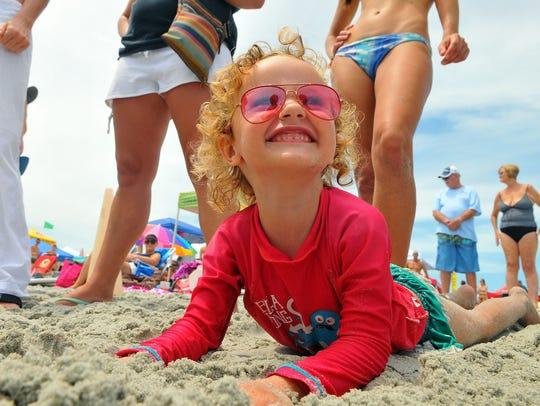 Charli Bardez age 3 of Cocoa Beach enjoys the sand