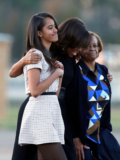 Malia Obama, First Lady Michelle Obama, and Marian