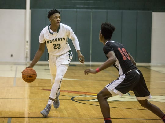 New Haven sophomore Romeo Weems drives the ball down