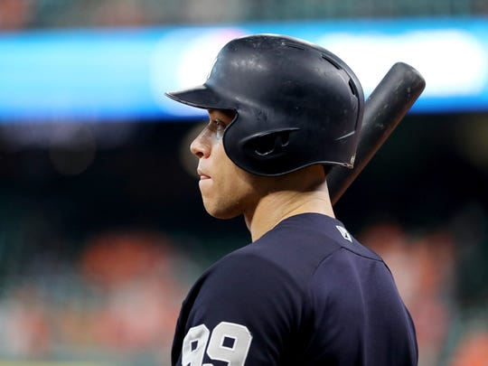 HOUSTON, TX - OCTOBER 21:  Aaron Judge #99 of the New York Yankees looks on during batting practice prior to Game Seven of the American League Championship Series against the Houston Astros at Minute Maid Park on October 21, 2017 in Houston, Texas.