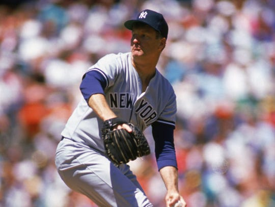 Tommy John delivers a pitch for the New York Yankees