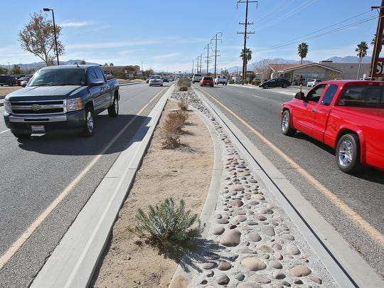 Traffic makes its way through the heart of Yucca Valley, November 11, 2014.  The city recently added these medians as a safety measure.
