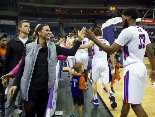 UE women's basketball player Hannah Noe gives a high-five