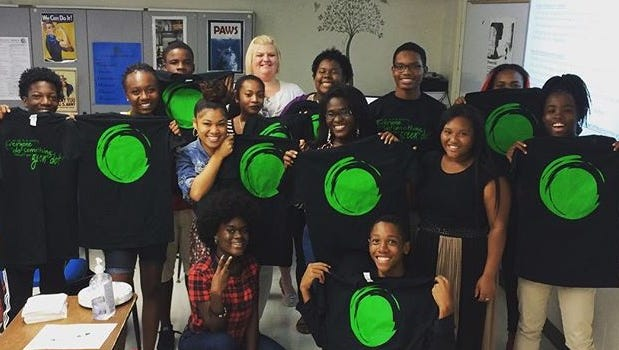Students at Rickards display their Green Dot t-shirts.