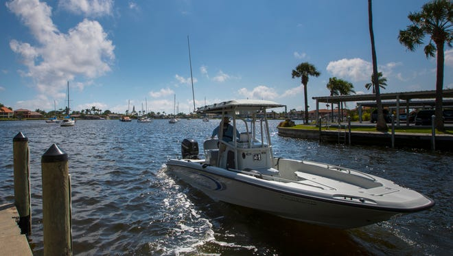 A member of the Cape Coral Police Department's marine division patrols the area of Bimini Basin near Downtown Cape Coral on the afternoon of April 9, 2018.