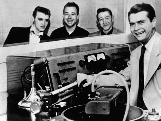 """Elvis Presley, Bill Black, Scotty Moore and Sam Phillips at Memphis Recording Service, 706 Union Ave., in 1954.  On the night of July 5, 1954, Phillips would record the threesome doing Arthur """"Big Boy"""" Crudup's song """"That's All Right."""" Within a week, they backed it with """"Blue Moon of Kentucky,"""" which had been a hit for Bill Monroe in 1946. It was the first of five Elvis singles recorded on the Sun label. Memphis Recording Service later became known as Sun Studio."""