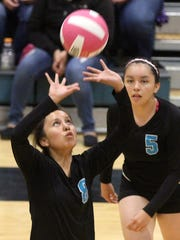 Navajo Prep's Taina Sandoval sets the ball against Shiprock on Tuesday at the Eagles Nest.