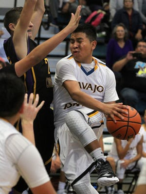 Navajo Prep's Tyler Morgan draws contact from the Kirtland Central JV defense on Saturday at the Eagles Nest.