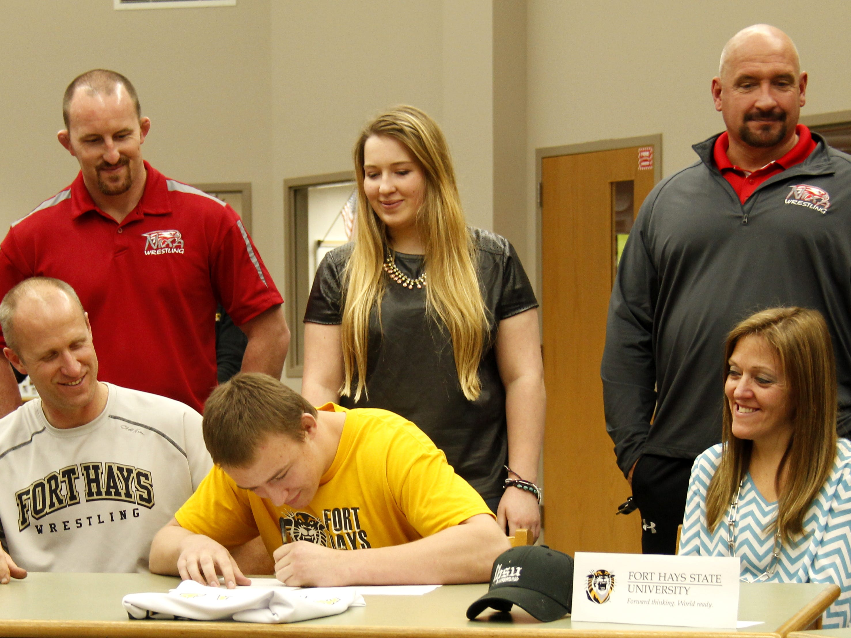 Nixa High School senior Christian Lance signs a national letter of intent to wrestle for Fort Hays State University on Wednesday.