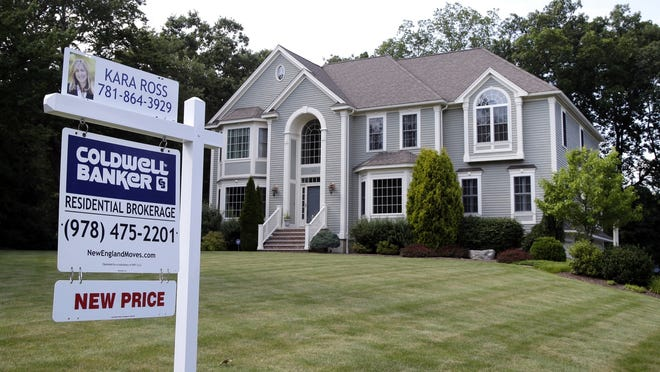 This file photo shows a house for sale in North Andover.