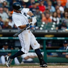 Sep 14, 2014; Detroit, MI, USA; Detroit Tigers second baseman Ian Kinsler (3) hits a two run home run in the seventh inning against the Cleveland Indians at Comerica Park. Mandatory Credit: Rick Osentoski-USA TODAY Sports