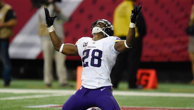 Nov 29, 2015: Minnesota Vikings running back Adrian Peterson (28) reacts after scoring a touchdown against the Atlanta Falcons during the fourth quarter at the Georgia Dome. The Vikings defeated the Falcons 20-10.