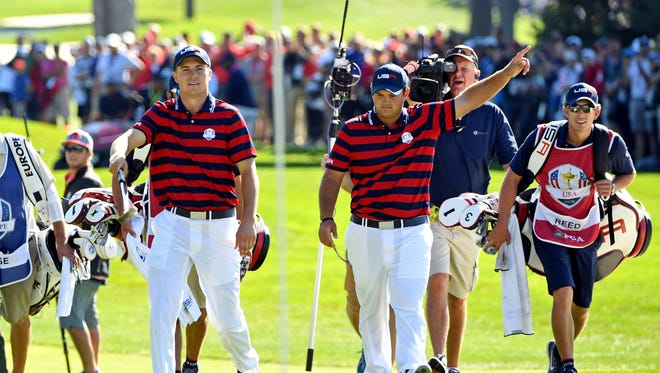 Jordan Spieth and  Patrick Reed celebrate on the sixth green during the afternoon four-ball matches in the 41st Ryder Cup at Hazeltine National Golf Club.