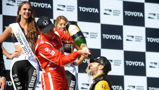 April 9, 2017; Long Beach, CA, USA; Sebastien Bourdais pours champagne on James Hinchcliffe following his victory of the Toyota Grand Prix of Long Beach at Streets of Long Beach.