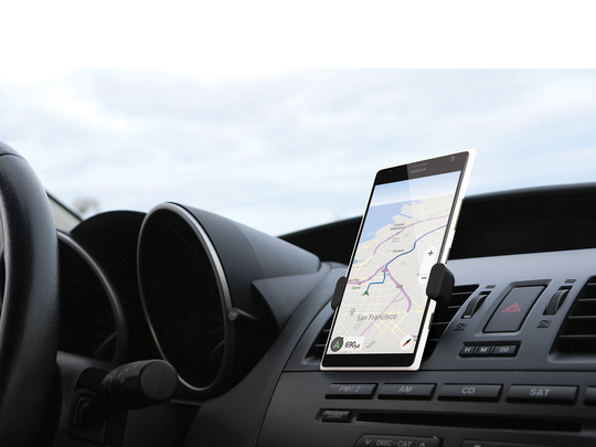 This smartphone holder snaps to your dash.