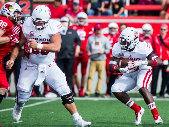 South Dakota freshman running back Kai Henry, right,