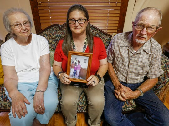 Mariya Adams, the aunt of Mayra Von Brandt, holds a photo of her niece from when she was younger while sitting on the couch with her parents David and Meredith Adams on Wednesday, July 12, 2017. Von Brandt has been held in the Greene County Jail longer than anyone else.