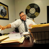 Assistant Public Defender for the 26th Judicial District Michael Miller works in his office in 2013. He was working on 455 cases, including 144 felony cases and 267 misdemeanor cases.