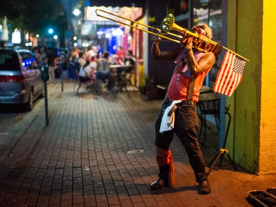Street performer John Mills, also known as John the Revelator, plays music on his trombone for passersby on Jefferson Street in downtown Lafayette in this Advertiser file photo.