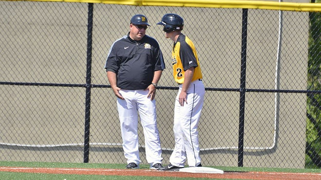 Northern Kentucky University head coach Todd Asalon coaches baserunner Ryan LeFevers during his 600th victory in 2014.