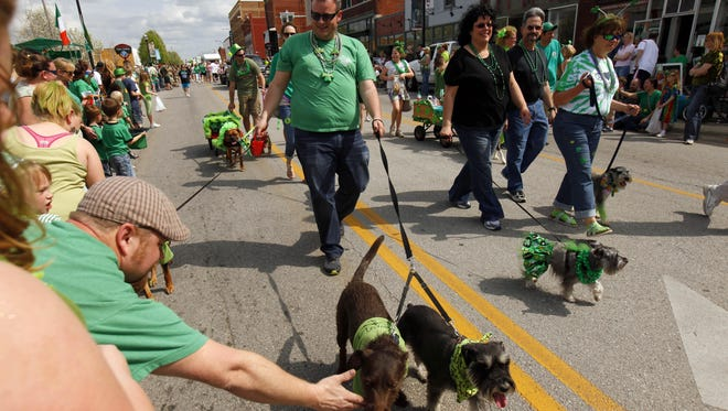 The annual St. Patrick's Day Parade trots along Commercial Street on Saturday afternoon. The Irish Pet Contest, held at 12:30 p.m., preceded the parade.