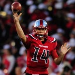 White tosses 4 TDs, WKU tops Old Dominion