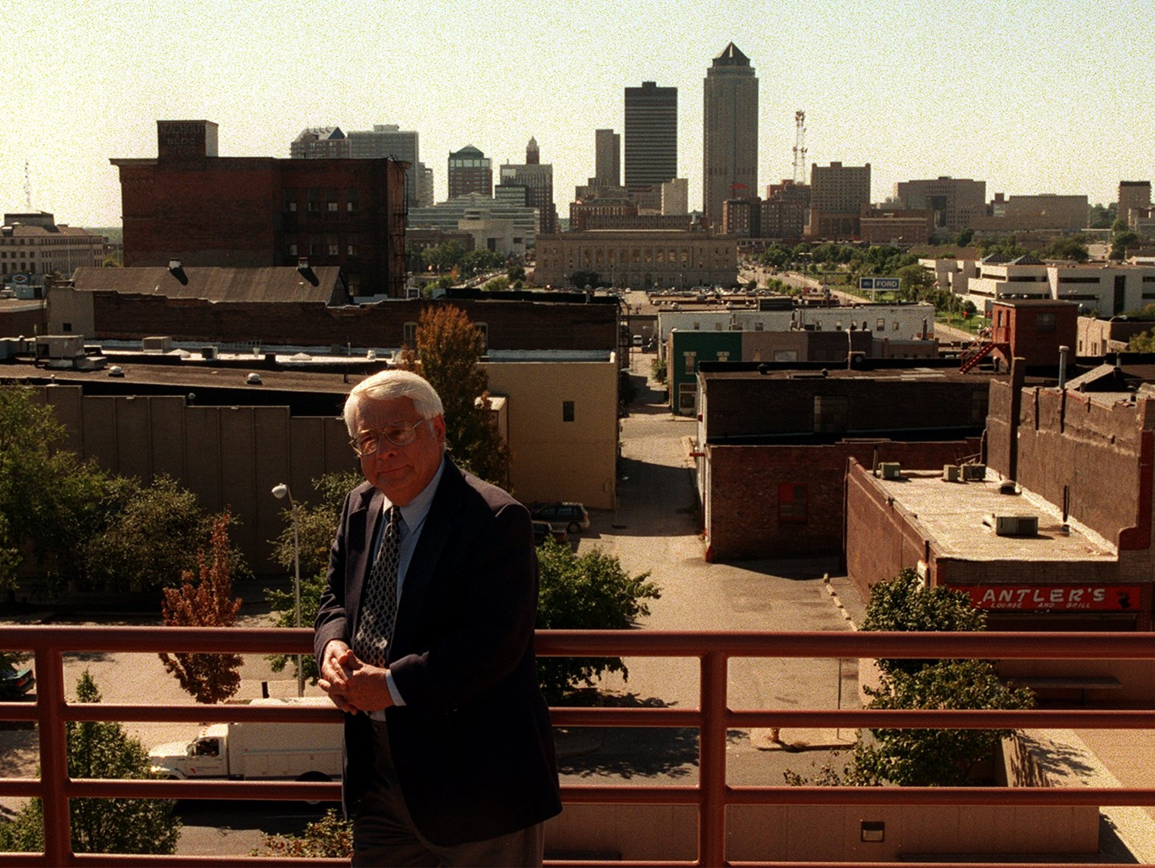 Jim Boyt stands on the roof of the Iowa State Historical