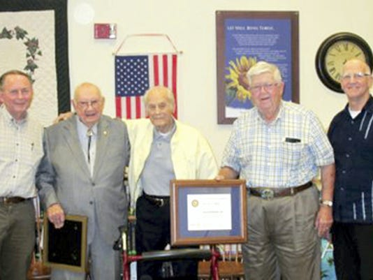 On  Sept. 10, Harold Mohn, center, was presented with the Paul Harris Fellow Award by members of the Myerstown-Elco Rotary. Recognized for his lifetime efforts and accomplishments through his poetry, Mohn has touched the lives of people here in Lebanon County, throughout the United States and around the world. The Paul Harris Fellow recognition acknowledges individuals who contribute, or who have contributions made in their name, of $1,000 to The Rotary Foundation of Rotary International. Submitted