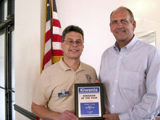 Mike Kuhn was selected by the Kiwanis Club of Lebanon as its 2015 recipient of its Kiwanian of the Year award. Mark Hoffman, left, chairman of the Selection Committee, presents the award to Kuhn. is instrumental in the clubâ  s Rose Sale fundraiser and also serves as the Athletic Scholarship chairman. Additional volunteer responsibilities include organizing the pancake breakfasts held the second Saturday from October through March at the Optimist Club in Lebanon.  He has served in the club for over 25 years.  Submitted