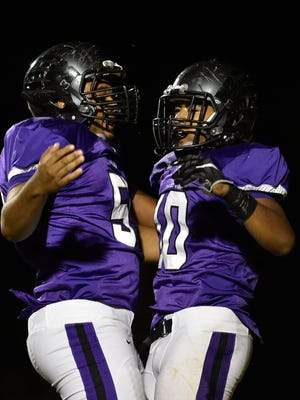 Cane Ridge's Josh Spouse (50) celebrates with Jordan Bell (10) after a touchdown against Summit on Friday, November 4, 2016.