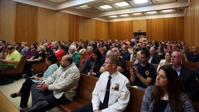 Mount Pleasant officials and residents attend a meeting concerning recent security issues at the two local residential centers for teens at Mount Pleasant Town Hall on May 23, 2016.