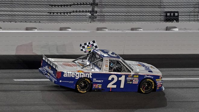 Johnny Sauter celebrates his victory in the NextEra Energy Resources 250, his third in the annual Camping World Truck Series opener at Daytona International Speedway.