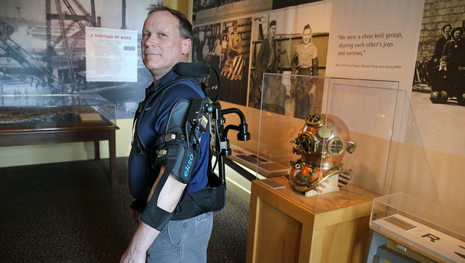 PSNS worker Ron Zmijewski wears an upper body exoskeleton at the Naval Museum in downtown Bremerton. The shipyard has partnered with a Utah robotics company to find new uses for exoskeletons and robots in its work.