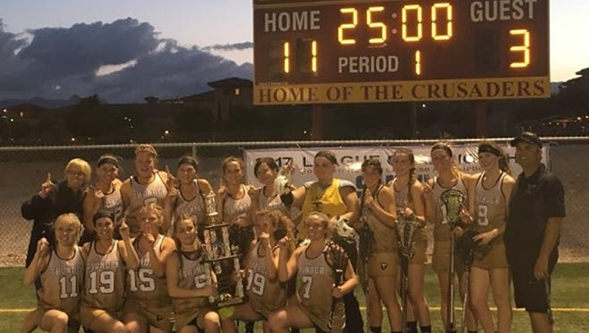 The Desert Hills girls lacrosse team, which consists of players from surrounding area high schools, pose for a picture after taking down Bishop Gorman to win the southern Nevada championship. The team will play for the state title this weekend in Reno.