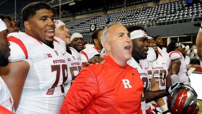 Rutgers Scarlet Knights head coach Kyle Flood sing the school fight song after defeating Washington State at Centurylink Field.