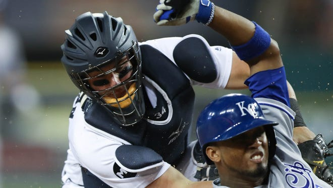 Tigers catcher James McCann applies the tag to the Royals' Alcides Escobar who scored in the seventh inning Wednesday, July 26, 2017 at Comerica Park.