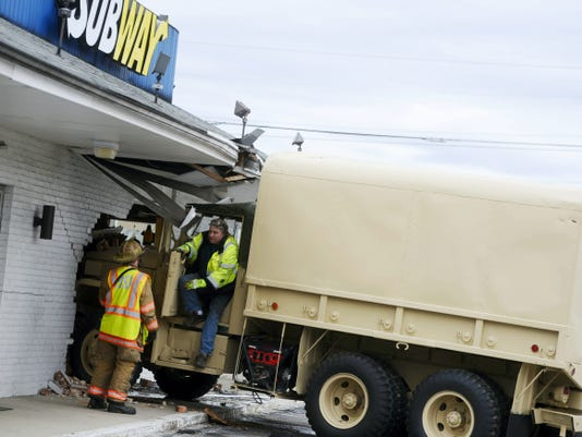 Two people were struck when a privately-owned former military vehicle crashed into Subway on North Hills Road Tuesday.