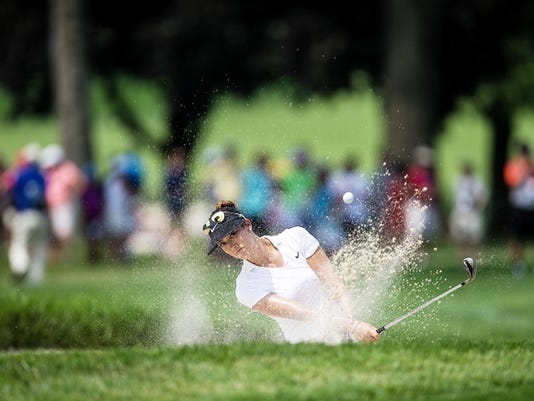 Michelle Wie hits out of a bunker on the 18th hole during a practice round for the U.S. Women's Open golf tournament Lancaster Country Club, Tuesday, July 7, 2015, in Lancaster, Pa. (Sean Simmers/PennLive.com via AP)