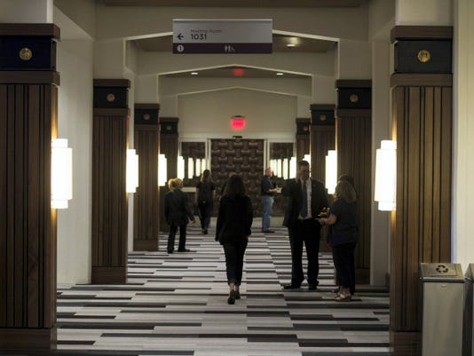 People take self-guilded tours Thursday of The Hershey Company new office building — 19 East — in downtown Hershey. The company held a grand opening ceremony to mark the completion of the two-year project.
