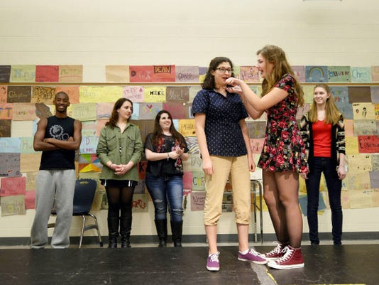 """Theresa Bova, 17, left, and Sarah Crawford, 17, do a skit around the words """"peanut butter"""" during CYHS improv team rehearsal at Central York High School."""