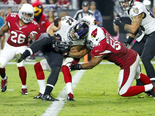 Baltimore Ravens tight end Nick Boyle (82) scores a two-point conversion as Arizona Cardinals middle linebacker Kevin Minter (51) defends during the second half of Monday's game in Glendale, Ariz. The Cardinals won, 26-18.