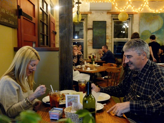 Debbie and Jim Craft of Springettsbury Township eat dinner at Warehouse Gourmet Bistro & Brew Pub. The Bistro & Brew Pub in Hanover features a special, weekly dinner menu for its downstairs dining area.