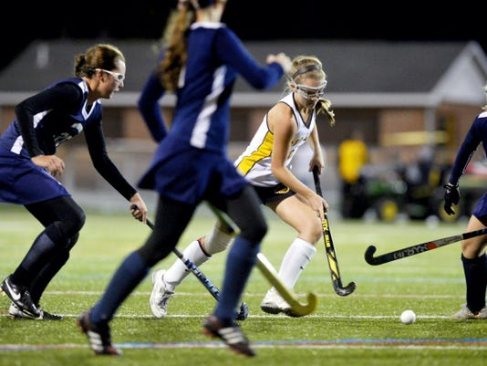 Red Lion's Samantha Collis drives against New Oxford defenders in the second half of a YAIAA Division I field hockey game Thursday at Red Lion. The Lions defeated the Colonials, 2-1.