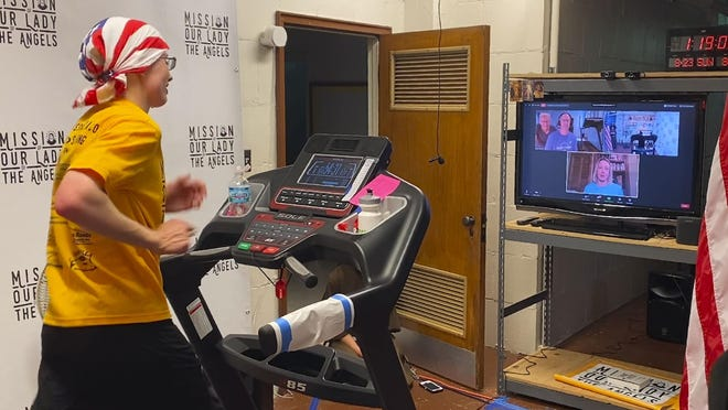 Sister Stephanie Baliga, 32, runs a marathon in August on a treadmill in the basement of the Mission of Our Lady of the Angels church in Chicago. When the Chicago Marathon was canceled due to the coronavirus pandemic, Baliga and her fellow nuns livestreamed her race and raised money for their community.