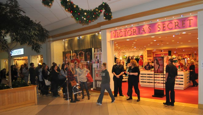 Shoppers wait to gain entry into Victoria's Secret early on Black Friday.